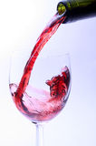 Pouring red wine. Into glass Stock Photo