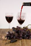 Pouring Red Wine. Red Wine being poured into a wine glass Stock Images