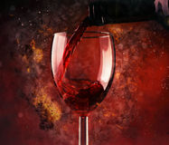 Pouring red wine and background Stock Image