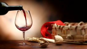 Pouring red wine into baloon wineglass. HD cinemagraph stock footage