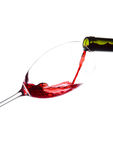 Pouring red wine from bottle to glass isolated Stock Image
