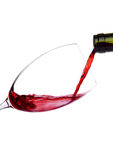 Pouring red wine from bottle to glass isolated Royalty Free Stock Photo