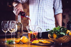 Pouring red wine into a carafe Royalty Free Stock Image