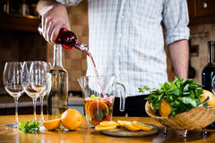 Pouring red wine into a carafe Stock Photos