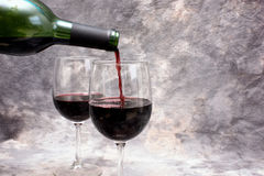 Pouring red wine with copy space Stock Photography