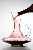 Pouring red wine into decanter Royalty Free Stock Photos