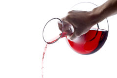 Pouring Red Wine from a Decanter Royalty Free Stock Photos