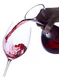 Pouring Red Wine from a Decanter Stock Images