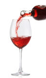 Pouring red wine into a glass Royalty Free Stock Photo