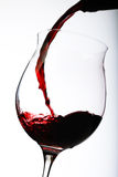 Pouring red wine in a glass Stock Image