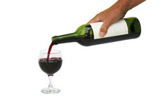 Pouring red wine into glass Royalty Free Stock Image