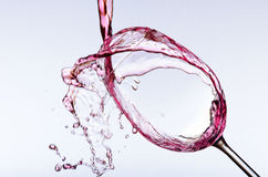 Pouring wine in glass Stock Images