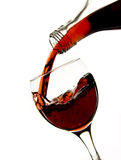 Pouring red wine in glass Royalty Free Stock Photos