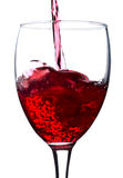 Pouring red wine in glass Stock Photos