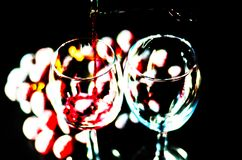 Pouring red wine in a glass, celebration of a moment with a glas. S of wine, exquisite liquor for gourmets, winery Royalty Free Stock Image