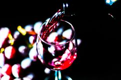 Pouring red wine in a glass, celebration of a moment with a glas. S of wine, exquisite liquor for gourmets, winery Royalty Free Stock Images
