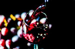 Pouring red wine in a glass, celebration of a moment with a glas. S of wine, exquisite liquor for gourmets, winery Royalty Free Stock Photo