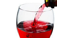 Pouring red wine into glass Stock Image
