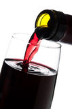 Pouring red wine isolated Royalty Free Stock Images