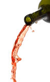 Pouring red wine, liquid falling Royalty Free Stock Image