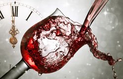Pouring red wine at midnight Stock Image