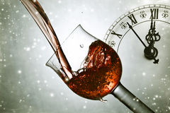 Pouring red wine at midnight Royalty Free Stock Photo