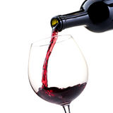 Pouring red wine into a wineglass Stock Image