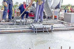 Pouring reinforced concrete in foundation mold Royalty Free Stock Images