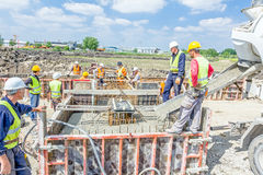Pouring reinforced concrete in foundation mold Royalty Free Stock Image