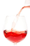 Pouring rose in glass Stock Images
