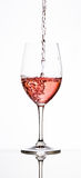 Pouring Rose into wine glass Royalty Free Stock Photography