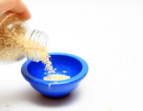 Pouring Sesame Seeds Stock Images
