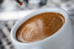 Pouring simple espresso with coffee machine Royalty Free Stock Photography