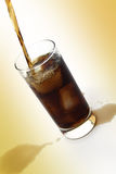 Pouring Soda. Puring soda into a glass. retouched photo for your design use Stock Image