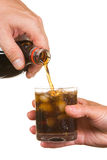 Pouring soda into a glass Stock Image