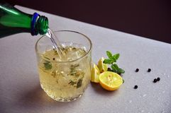 Pouring soda in mojito glass Royalty Free Stock Images