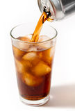 Pouring Soda. A stream of cola pours into an icy glass Stock Images