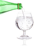 Pouring soda water from glass bottle Royalty Free Stock Image