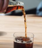 Pouring a soft drink cola in a pub Stock Photos