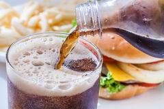 Pouring soft drink Royalty Free Stock Photography