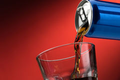 Pouring a soft drink in a glass Stock Photo