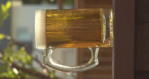 Pouring some beer on a mug during an afternoon during the summer. In Calgary AB, Canada on a vertical screen view stock video