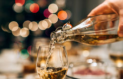 Pouring some wine for Christmas dinner Royalty Free Stock Images