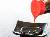 Pouring soy sauce Royalty Free Stock Photos