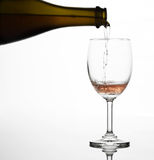 Pouring sparking rose wine on the wine glass Stock Photos