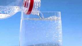 Pouring sparkling water into a glass stock footage