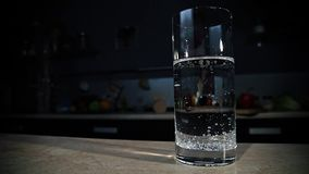 Pouring sparkling water into the glass stock video footage