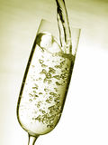 Pouring sparkling wine Stock Image