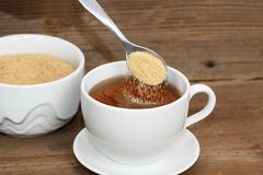 Pouring sugar Royalty Free Stock Photo