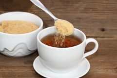 Pouring sugar Stock Image